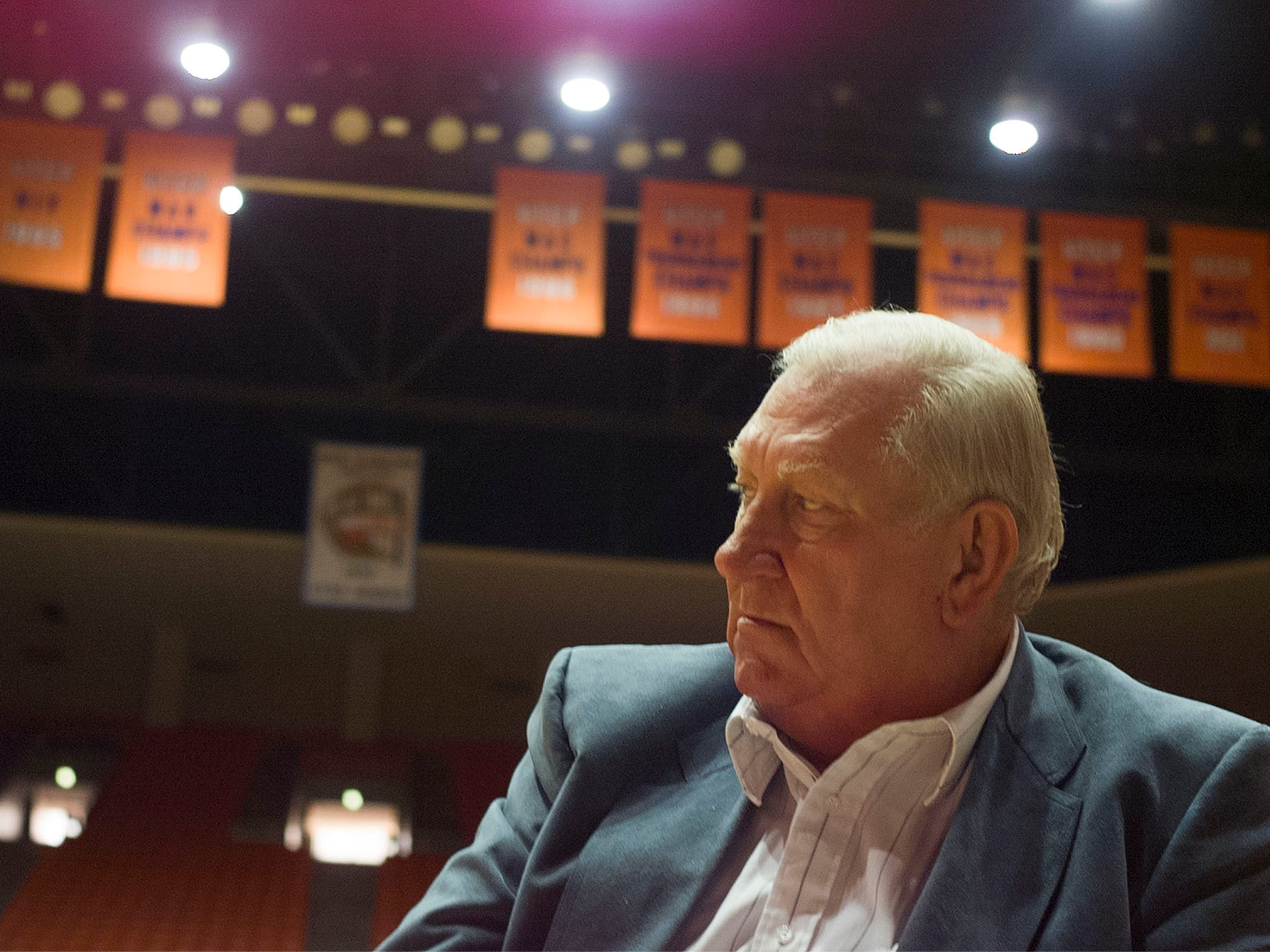 Former UTEP basketball coach, Don Haskins, waited to be interviewed by television reporters in the Don Haskins Center. Haskins announced his retirement after 38 years as head coach.