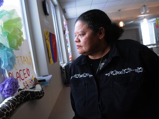 In this Nov. 26, 2014, photo, Marquita Clardy stands in the common living area at Brittany's Place: The Safe and Sound Shelter in St. Paul, Minn. Volunteering at a St. Paul shelter for girls who are victims of sex trafficking has become pivotal to Clardy after her daughter, Brittany Clardy, was killed. Minnesota has become a national model for combating sex trafficking, particularly with its investment of state funds to support the victim.