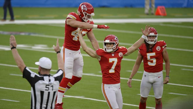 Kansas City Chiefs kicker Harrison Butker (7) celebrates after making the game-winning field goal during overtime Sunday against the Los Angeles Chargers in Inglewood, Calif. Kansas City won 23-20.