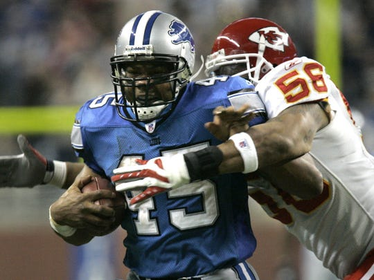 T.J. Duckett (45), then a Detroit Lions running back, is stopped by Kansas City Chiefs linebacker Derrick Johnson (56) after a 53-yard run to the Chiefs' 9-yard line during a game in Detroit on Sunday, Dec. 23, 2007. Duckett ran for a season-high 102 yards and a touchdown, helping Detroit hold on for a 25-20 win.