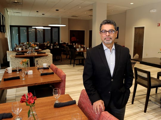 November 9, 2016 - Nagib Lakhani, CHO RevMAX Hospitality Consulting Services, stands in the recently refurbished dining area of the Crowne Plaza Downtown Memphis. The $7 million renovation that yielded 230 refurbished guest rooms and an all-new lobby and fitness center. The hotel was bought last year by out-of-town owners, including a family with historical ties to St. Jude.
