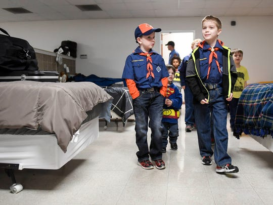 Members of Cub Scout Pack 383 from Aldersgate United Methodist Church check out the sleeping quarters during a tour of Evansville's Station 16 Fire Station Saturday, April 1, 2017.