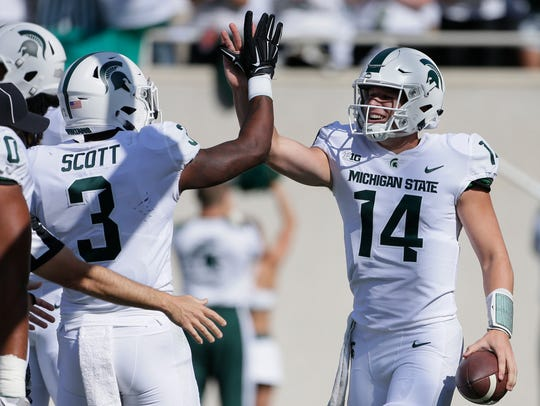 Much of MSU's expectations are riding on Brian Lewerke, left, and LJ Scott.