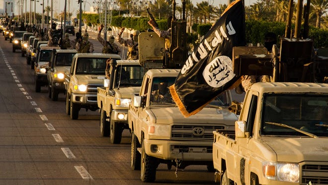 An image made available by propaganda Islamist media outlet Welayat Tarablos on Feb. 18, 2015, allegedly shows members of the Islamic State parading in a street in Libya's coastal city of Sirte.
