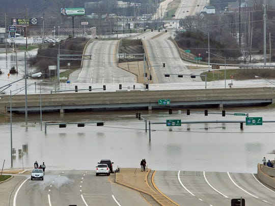 Floodwater from the Meramec River surrounds the bridge deck of Interstate 44 and Highway 141 in southwest St. Louis County, Mo.