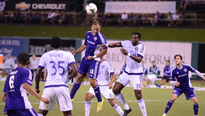 Ilija Ilic, center, heads a ball during Louisville City FC's Aug. 25 friendly with Orlando City SC.