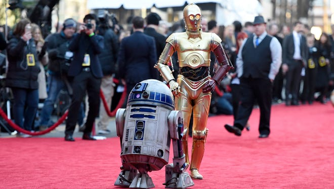 R2-D2 and C-3PO arrive at the world premiere of 'Star Wars: The Force Awaken's on Dec. 14.