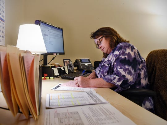 Admissions counselor Gail Mattocks works at her desk