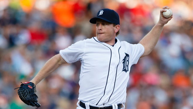 Detroit Tigers pitcher Randy Wolf (52) pitches in the second inning against the Texas Rangers at Comerica Park.