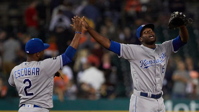 Royals shortstop Alcides Escobar, left, and center fielder Lorenzo Cain, right, celebrate after Kansas City's victory against the Tigers at Comerica Park in Detroit.