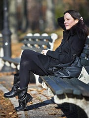"""In this Dec. 7, 2015 photo, actress and author Mary-Louise Parker poses for portrait in a park in the Brooklyn borough of New York. Parker's """"Dear Mr. You,"""" a collection of lyrical and often emotional essays about men addressed to everyone from former (and unnamed) lovers to family members, has been highly praised by critics and made the actress a respected name in the literary world. (AP Photo/Bebeto Matthews)"""