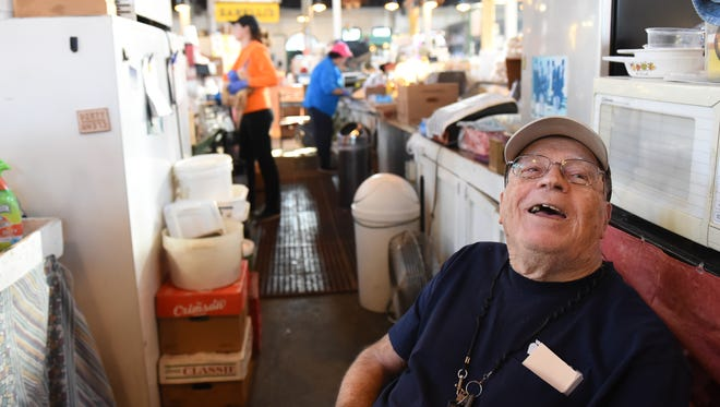 """This is a cheap chair, but it's comfortable,"" Fred Henry jokes as he sits at the stand, Henry's Ham, that his family owned for over 70 years."