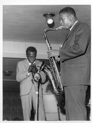 John Coltrane with Miles Davis.