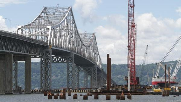 A view of the pilings that will support the new Tappan Zee Bridge, with the existing bridge in the background,