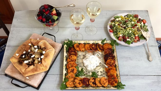 Rustic apple onion tart, sweet potato corn cakes and spiralized Greek salad puts vegetables front and center.