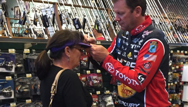 Bassmaster Elite angler Kevin VanDam signs the visor of Shreveport's Lisa Weaver Sunday afternoon at the Bossier City Bass Pro Shops.
