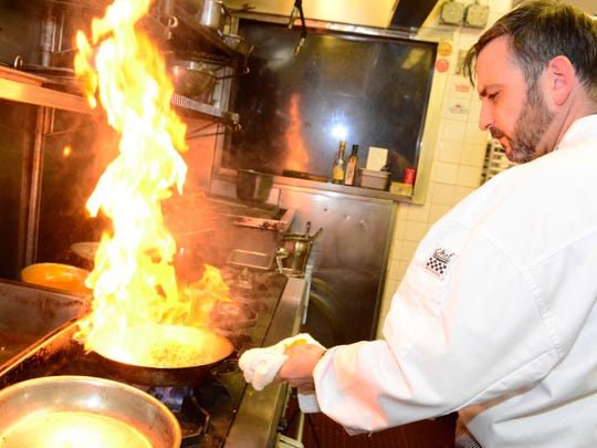 Charlie Meyer, chef de cuisine of Piccola Italia Restaurant, works in the kitchen at the Ocean Township eatery.