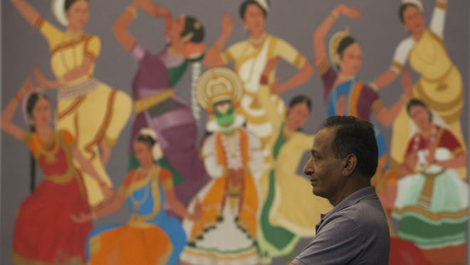 Indian Cultural Center manager Ramnik Dadhanik  stands near one of the murals by a renowned Indian artist at the Indian Cultural Center in Evesham.