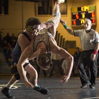 Roxbury and Old Tappan wrestlers compete in the 170-pound weight class in the NJSIAA North 1 Group IV final on Friday. For a full report and more photos from the meet, go to DailyRecord.com.