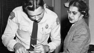 Mrs Rosa Parks, a Negro seamstress, being fingerprinted after her refusal to move to the back of a bus to accommodate a white passenger touched off the bus boycott, Montgomery, Alabama, 1956. (Photo by Underwood Archives/Getty Images)