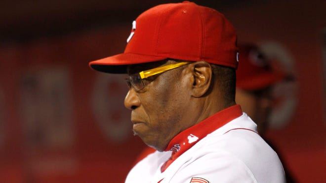 Cincinnati Reds manager Dusty Baker watches from the dugout in the second inning during a game against the New York Mets at Great American Ball Park.