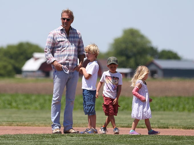 Actor Kevin Costner takes in the view from the Field of Dreams movie site with his sons Hayes Logan, 7,  Cayden Wyatt, 5, and daughter Grace Avery, 4, on Friday, June 13, 2014, outside Dyersville, Iowa.