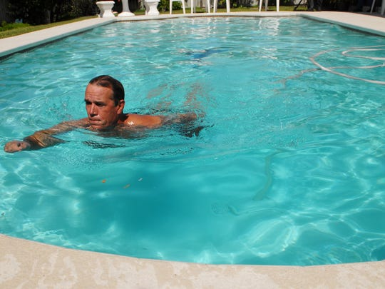 William Dillon swims in the pool at his family's home in Satellite Beach in 2009.