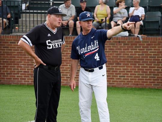 Vanderbilt head coach Tim Corbin chats with Mississippi
