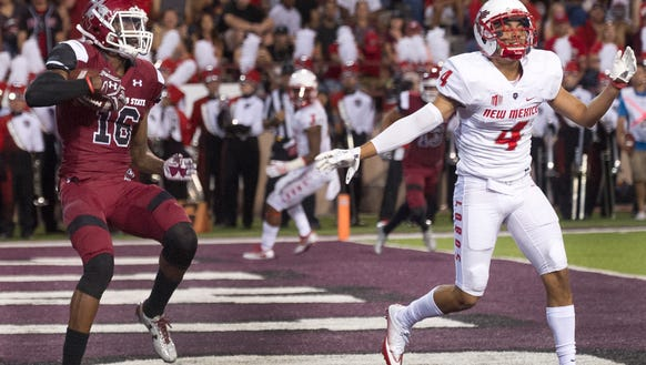 NMSU Jaleel Scott back pedals past Lobos Isaiah Brown