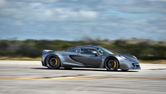 A Hennessey Venom GT drives down the runway at Kennedy Space Center as it sets a new world speed record for 2-seat cars by reaching a top speed of 270.49 mph in Cape Canaveral, Fla. on Feb. 14.