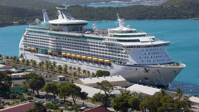 The Royal Caribbean International's Explorer of the Seas is docked at Charlotte Amalie Harbor in St. Thomas, U. S. Virgin Islands,  Jan. 26, 2014. U.S. health officials have boarded the cruise liner to investigate an illness outbreak that has stricken hundreds of people.