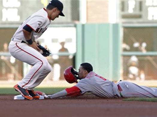 Billy Hamilton steals second base as Joe Panik grabs the throw during the first inning.