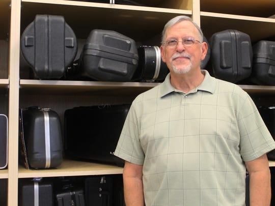 Band teacher Gary Hammer, who also serves president