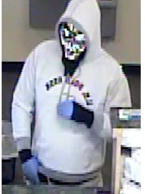 A man wearing a silver skull mask robbed the First Savings Bank at 1701 N. Saul Kleinfeld Drive on Nov. 3, 2016.