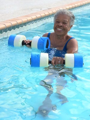 Wilhelmina Delco, a former Texas state lawmaker who turns 88 in July, exercises five days a week in the pool at the East Communities YMCA in Austin, Texas. (Sharon Jayson for KHN)