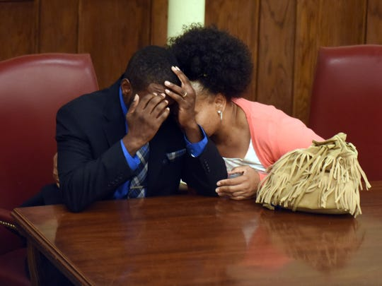 Ray Allen Thompson and his wife react after hearing the verdict of Thompson to be not guilty of the April 27, 2014, murder of Oliver Griffin.