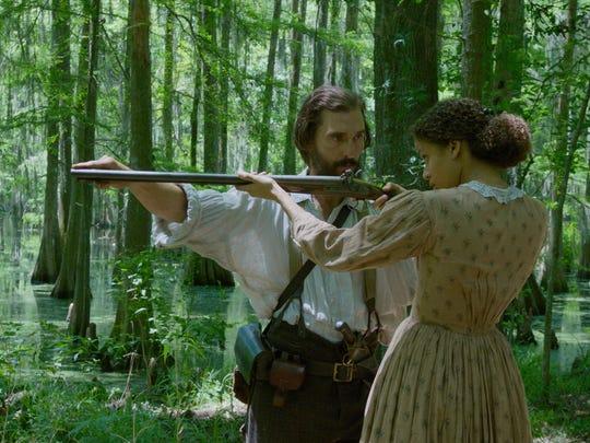 "Matthew McConaughey and Gugu Mbatha-Raw star in ""Free State of Jones."""
