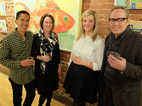 New gallery opening Main Street downtown Evansville welcomed a new establishment, the Rumjhan Gallery and Framery. A soft opening party was attended by featured artists and good friends with a tour of the beautifully appointed space and interesting art exhibits.  Posing in front of a Michael Key piece are owners Howie and Tina Rumjhan, Lindsay Meece and Michael Key.