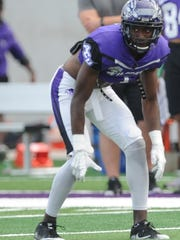 Cydney Calvin waits for the snap in ACU's final scrimmage of fall camp Saturday, Aug. 26, 2017 at Wildcat Stadium.