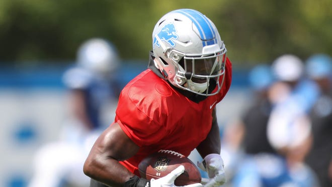 Lions running back Theo Riddick runs the ball during practice Tuesday, August 1, 2017 at the Allen Park practice facility.