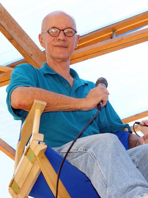 Dave Johnson at his usual perch high above the judges' roost during the Great American Duck Races. Johnson died Saturday following a lengthy illness.