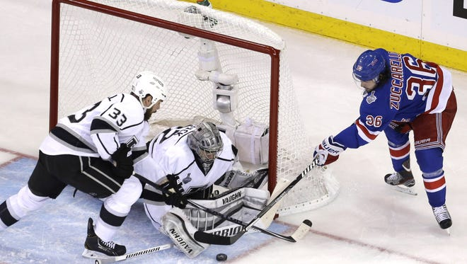 Rangers right wing Mats Zuccarello, right, tries to score past Los Angeles Kings goalie Jonathan Quick and defenseman Willie Mitchell in the second period during Game 4 of the Stanley Cup Final Wednesday night at the Garden.