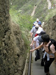Visitors to Diamond Head as they tackle the steep 1.6-mile