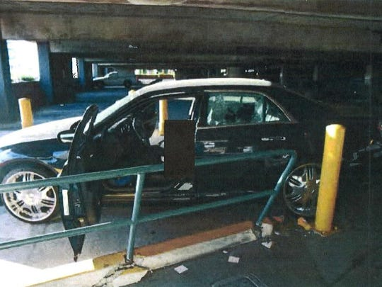 Cpl. Allan DeVillena II was driving this black Chrysler 300 when he was fatally shot by Palm Springs police on Nov. 10, 2012. After the shots were fired, the car crashed into a column near the east exit of the downtown parking garage.