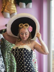 Eryn Shewell modeling the Bettie Page licensed Princess Seamed Bandeau Sheath bathing suit at Bettie's Bombshells.