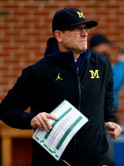 Jim Harbaugh is 28-11 at Michigan.