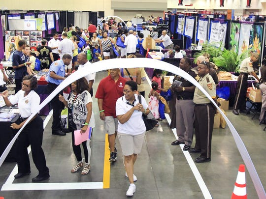 People walk through exhibits at Indiana Black Expo's Summer Celebration at the Indiana Convention Center in 2012.