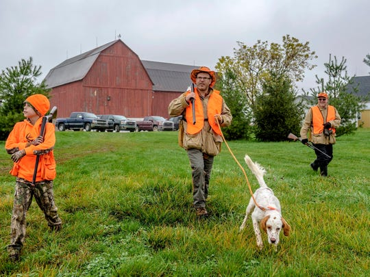 A family of hunters heads out at The Pheasant Farm in Grand Rapids, Mich., on Nov. 5, 2017.