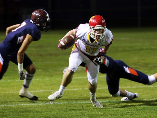 Palm Desert's Brooks Stephenson (11) breaks a tackle