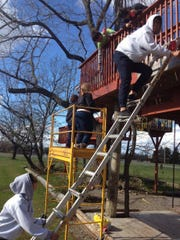 "Members of the Geneseo chapter of Alpha Phi Omega, a co-ed service organization, routinely volunteer at the tree house village. ""When we have 10 SUNY students staining wood for three hours, that's a whole week of work,"" said Heather Ferrero, who along with her husband, created the tree house village."